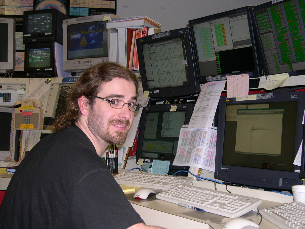 Photograph of Steve Beale at the D0 control room, working in experimental particle physics.