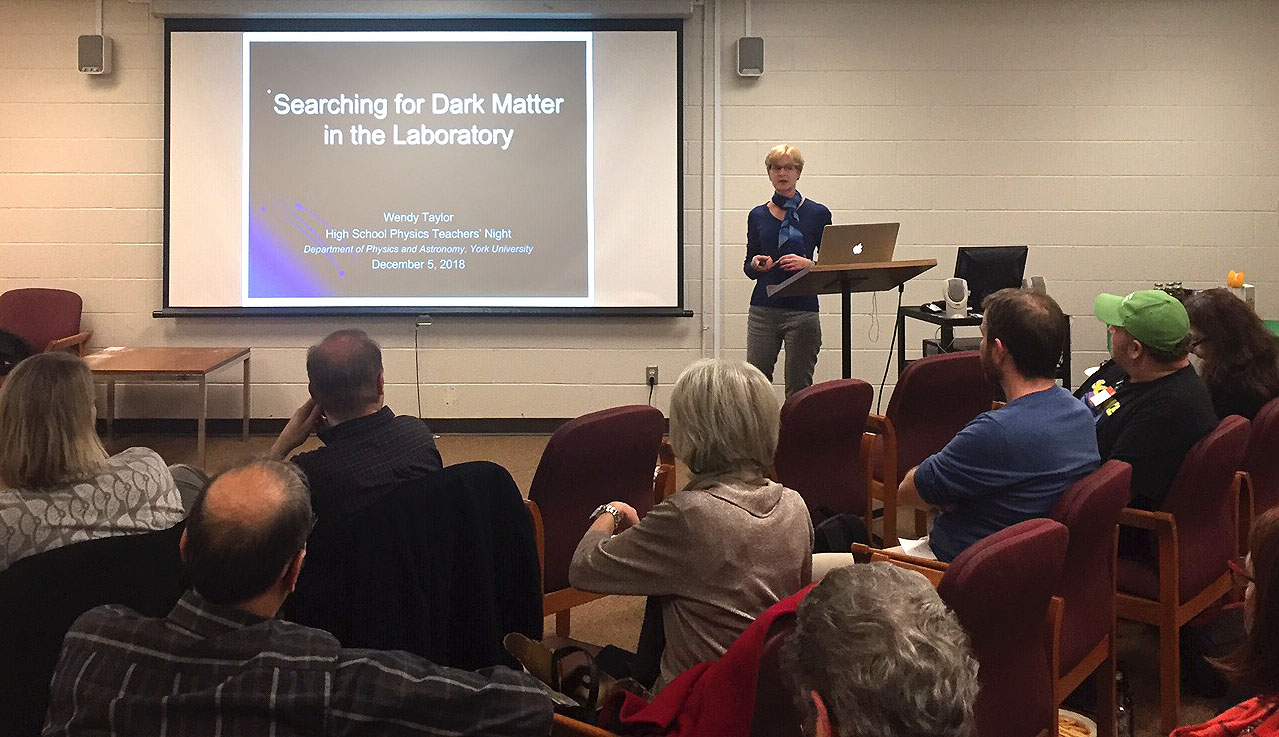 Photograph of Dr Wendy Taylor presenting at a high school physics teachers night.